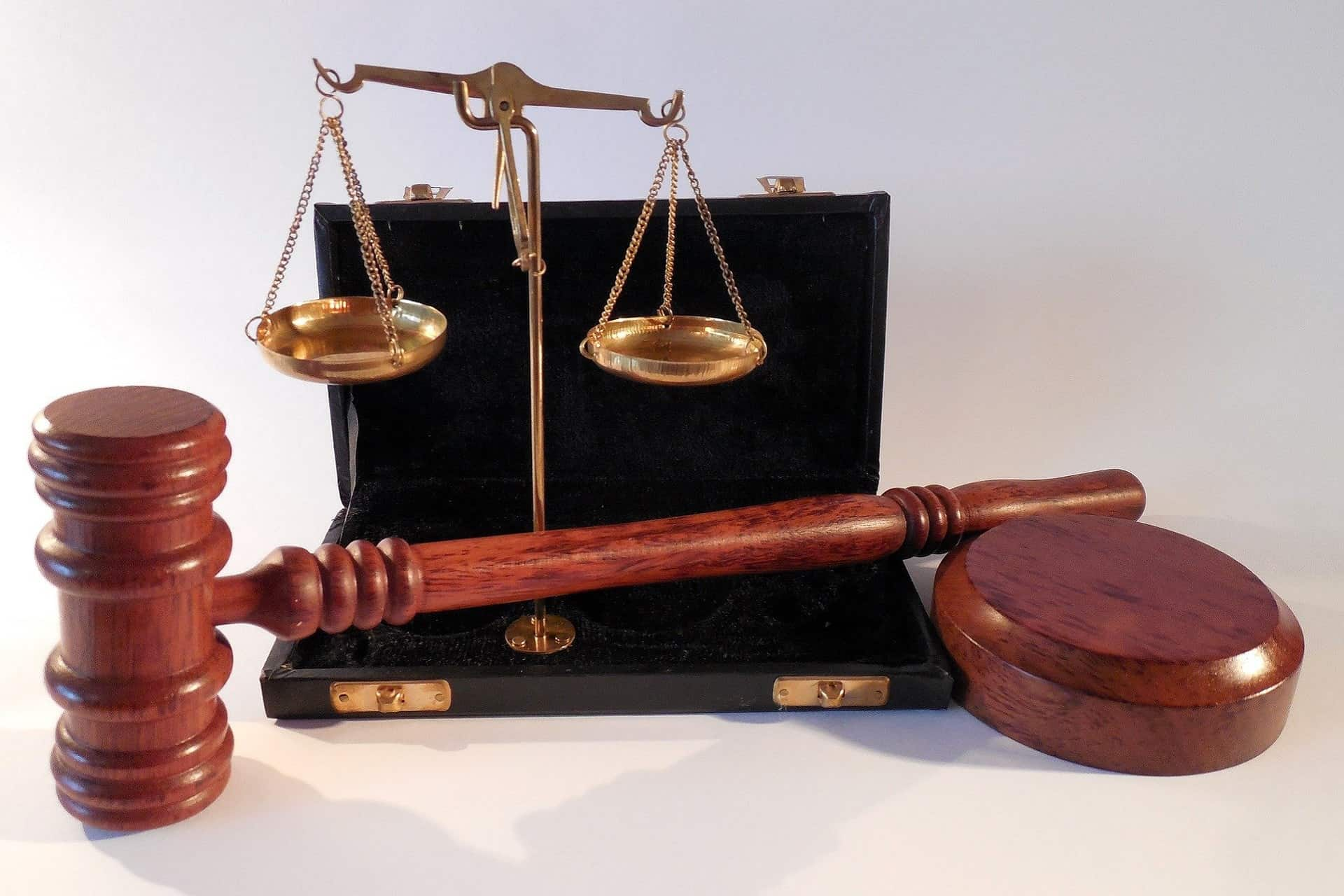 wooden gavel and bronze scales of justice